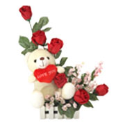 Breathtaking 6 Red Roses with a Teddy with Heart Shaped Cushion