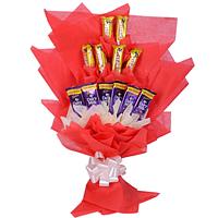 Delicious display of 6 Cadbury Dairy Milk N 6 Cadbury Five Star in Bouquet
