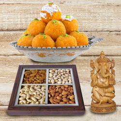 Auspicious Idol of Sandalwood Ganesha and 250 gms. each of Haldiram's Ladoo and Dry Fruits
