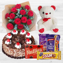 Refreshing Bouquet of 12 Dutch Red Roses with 1 Lb Cake, Mixed Cadburys Chocolates and a Teddy Bear