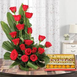 Brilliant Bouquet of 18 Red Roses with 1/2 Kg. Mixed Sweets