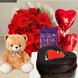 Artistic Red Roses, Chocolate Cake, Mylar Balloons, Chocolates and a Teddy