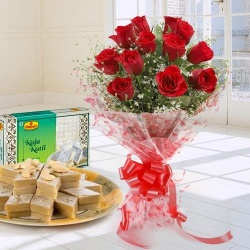 Lovely charming Red Roses combined with mouthwatering Kaju Katli