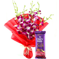 Anniversary Enjoyable Combo of Cadbury Silk and Orchids Bouquet