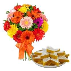 Anniversary Combo of Delicious Kaju Katli and Gorgeous Arrangement of Mixed Gerberas