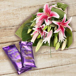 Impressive Anniversary Combo of Pink Lilies Bouquet and Dairy Milk Silk