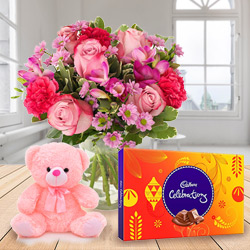 Expressive Mixed Flowers in a Vase with Small Teddy and Tasty Cadbury Celebration Chocolates for Anniversary