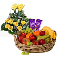 Delectable Dairy Milk Silk with Yellow Roses Arrangement and Fruits Basket