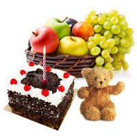 Bountiful Selection of Soft Teddy with Candles, Fresh Fruits Basket and Black Forest Cake