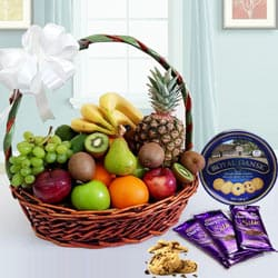 Delectable Fresh Fruits Basket with Danish Recipe Cookies N Chocolates
