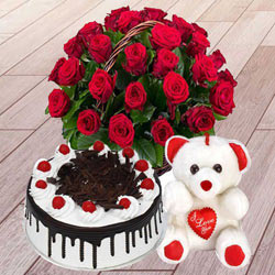 Ravishing 25 Red Roses with 1 Lb Black Forest Cake and a Teddy Bear