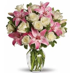 Distinctive display of Pink Lilies N White Roses in Glass Vase